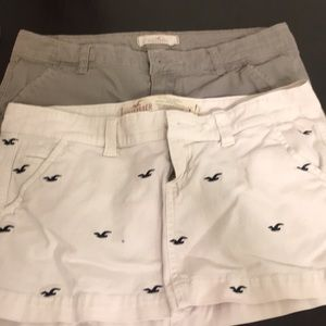 2 Hollister mini skirts one white one gray